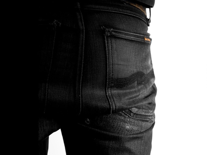 Well-worn black denim, one wash.